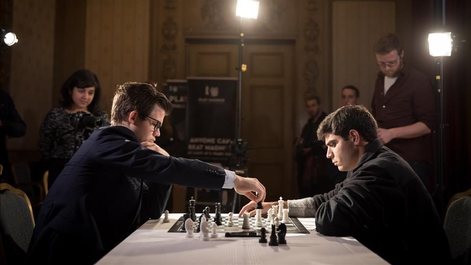 Image Represents A Person make a move in chess game and the other person watching and waiting for his next move