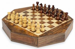 A Wooden Chess Board that placed on the table for playing.